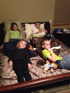 "The ""big kids"" watching a movie in Mom and Dad's room."